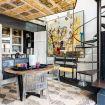 La zona cucina con tavolino in legno e credenza - Loft Valverde