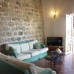 Il comodo soggiorno con divani e stereo- Giardino sul Mare